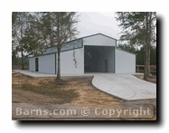metal barn with concrete